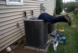 picture of a hvac technician working on a heating and air unit