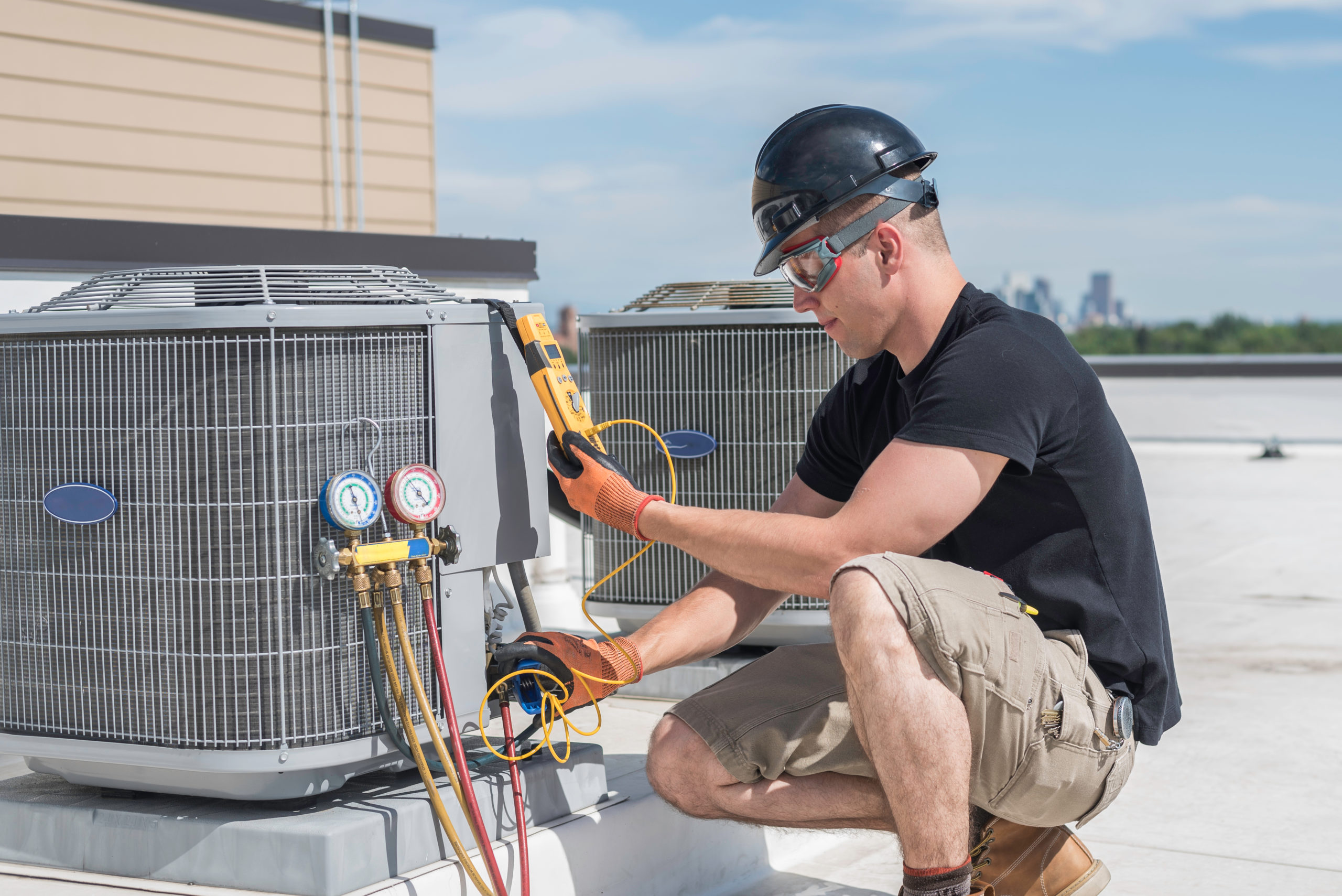 Man Working On Ac Unit
